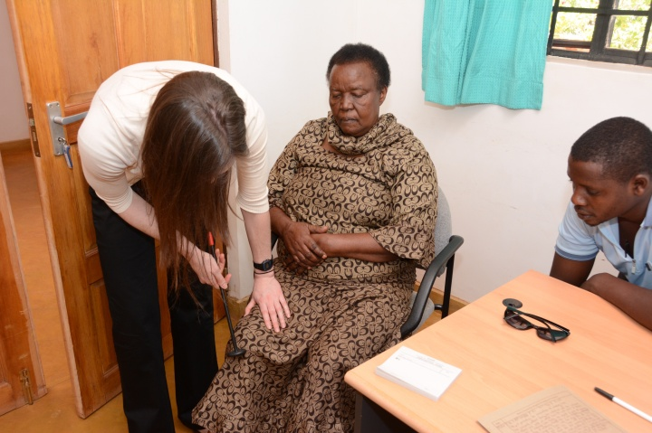 Christyn examining a patient