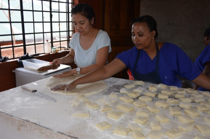 Thu and Julianna Rolling Mandazi
