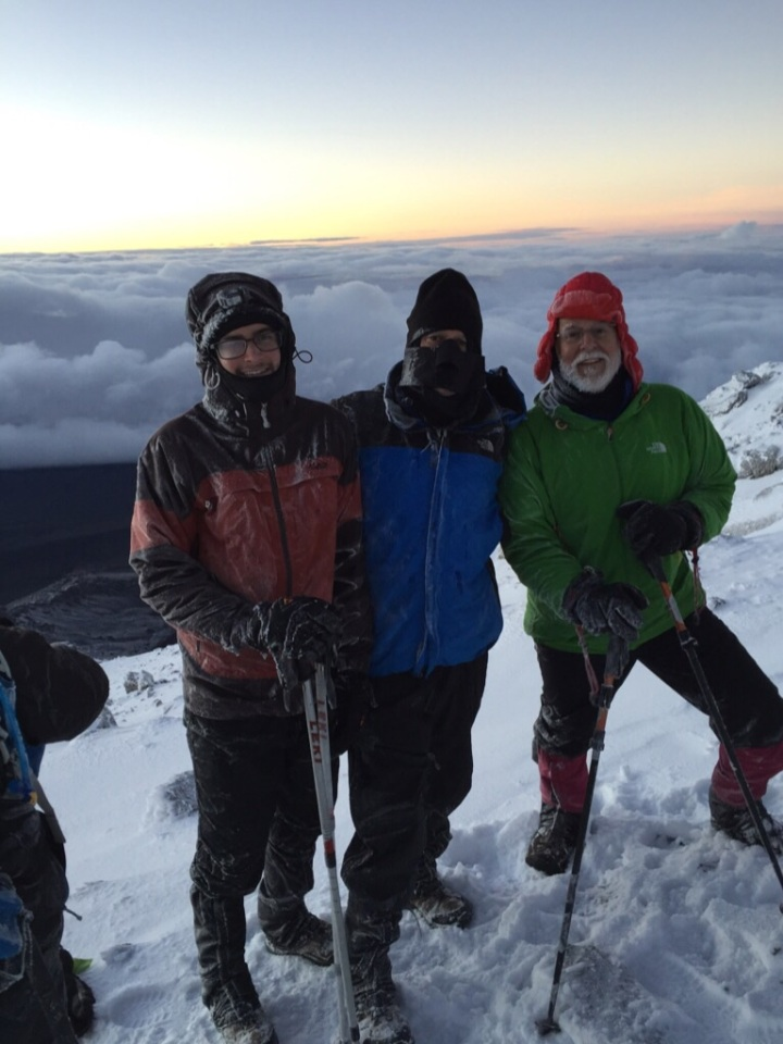 The Rubensteins on top of Kilimanjaro - Nick, Jeff and Mike