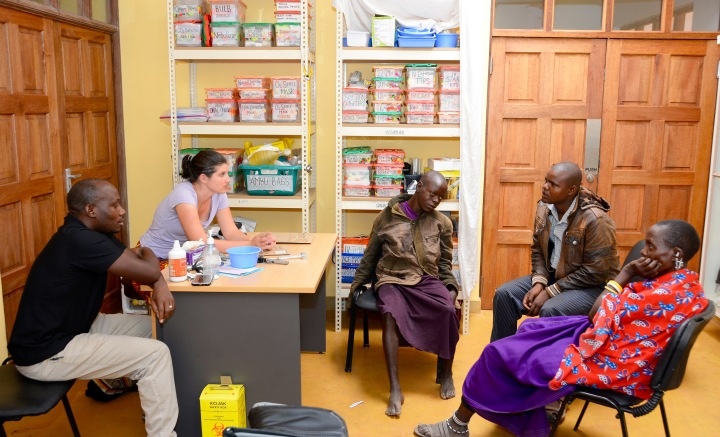 Jackie evaluating a young Maasai boy with seizures and developmental delay