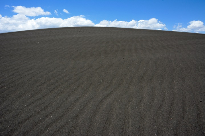 The black volcanic sand of shifting sands