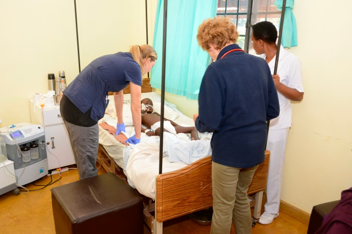 Nurse Barbara and Dr. Verena evaluating the young boy with meningoencephalitis