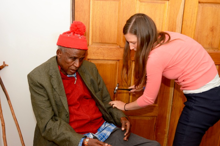 Kelley evaluating an elderly gentleman with a history of stroke