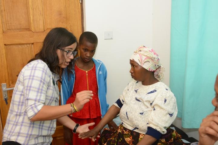 Laura teaching Renata the neuro exam
