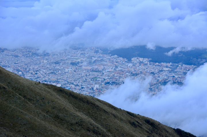 Looking down on Quito through the clouds